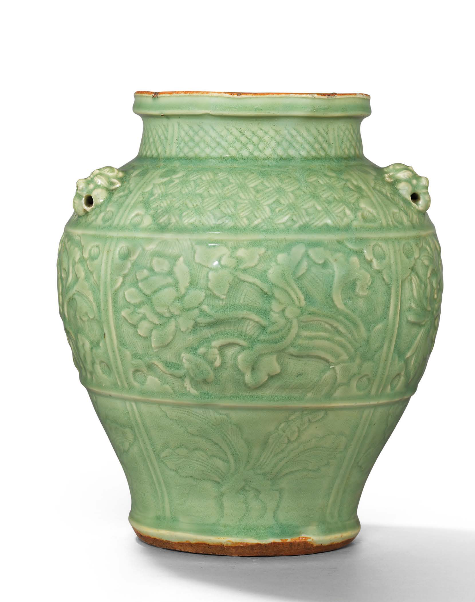An important and extremely rare carved Longquan celadon jar, Yuan dynasty (1279-1368)