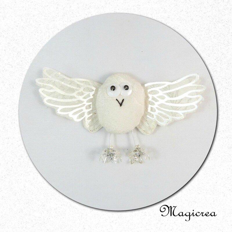 oiseau soie blanc ivoire