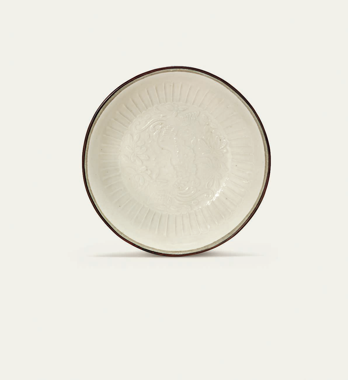 A rare small moulded 'phoenix' Ding dish, Jin dynasty (1115-1234)