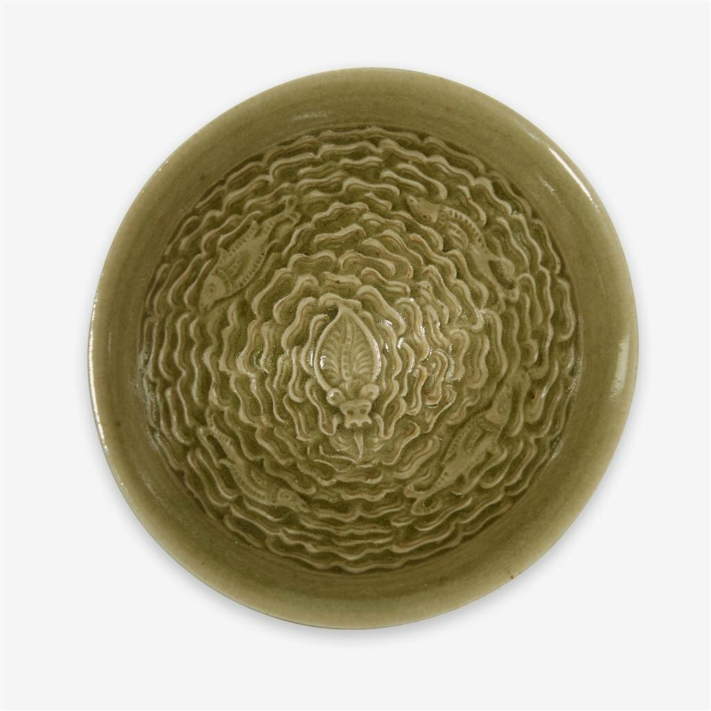 A Chinese 'Yaozhou' celadon carved 'three fishes' bowl, Northern Song dynasty (960–1127)