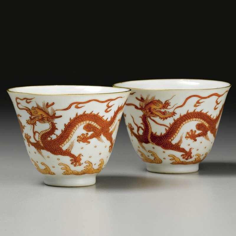 A pair of iron-red 'dragon' wine cups