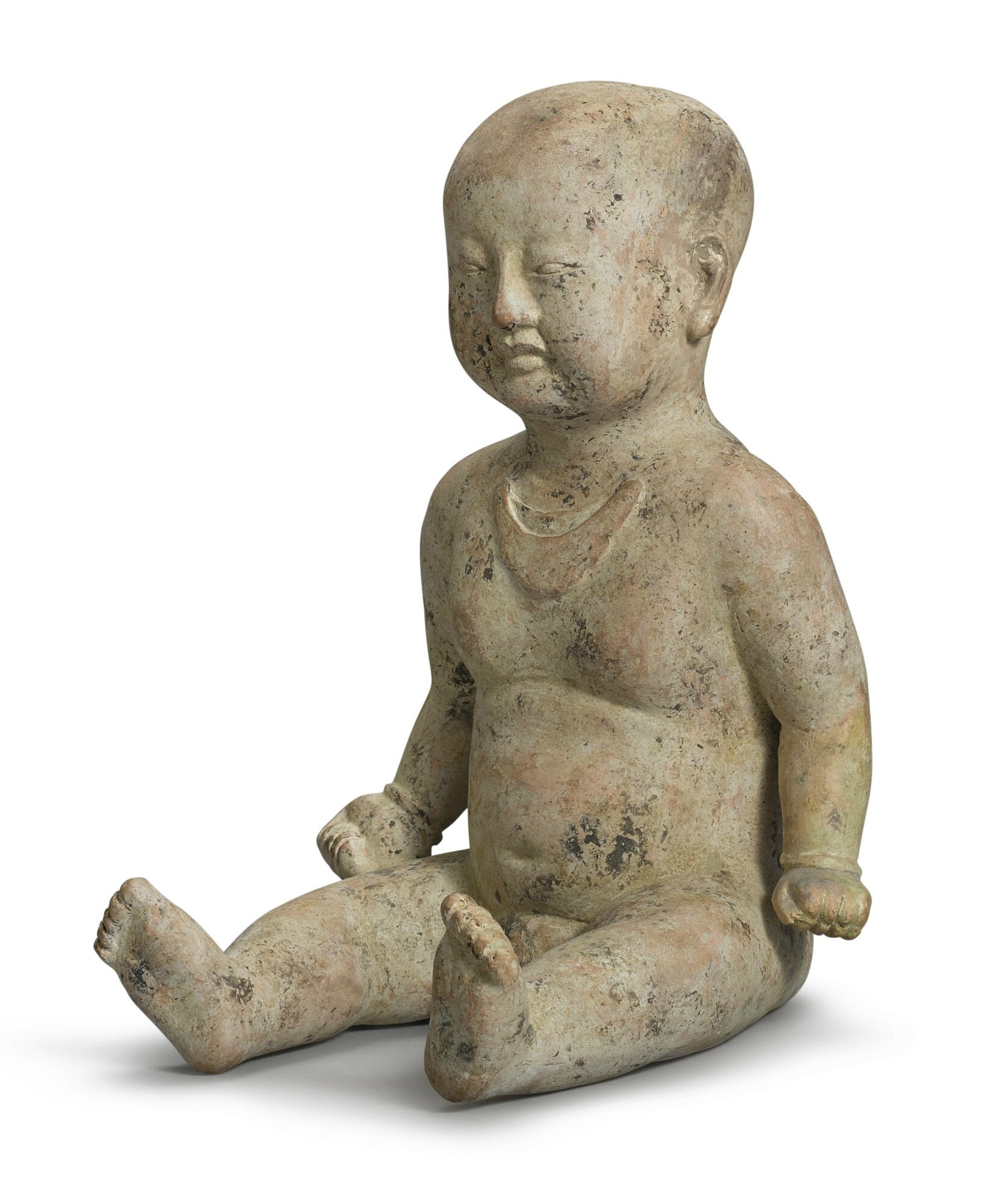 A rare painted pottery figure of a boy, Song dynasty (960–1279)