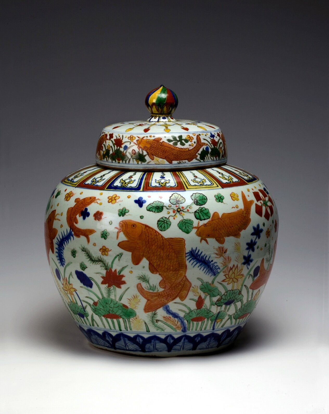 Covered jar with fish in lotus pond