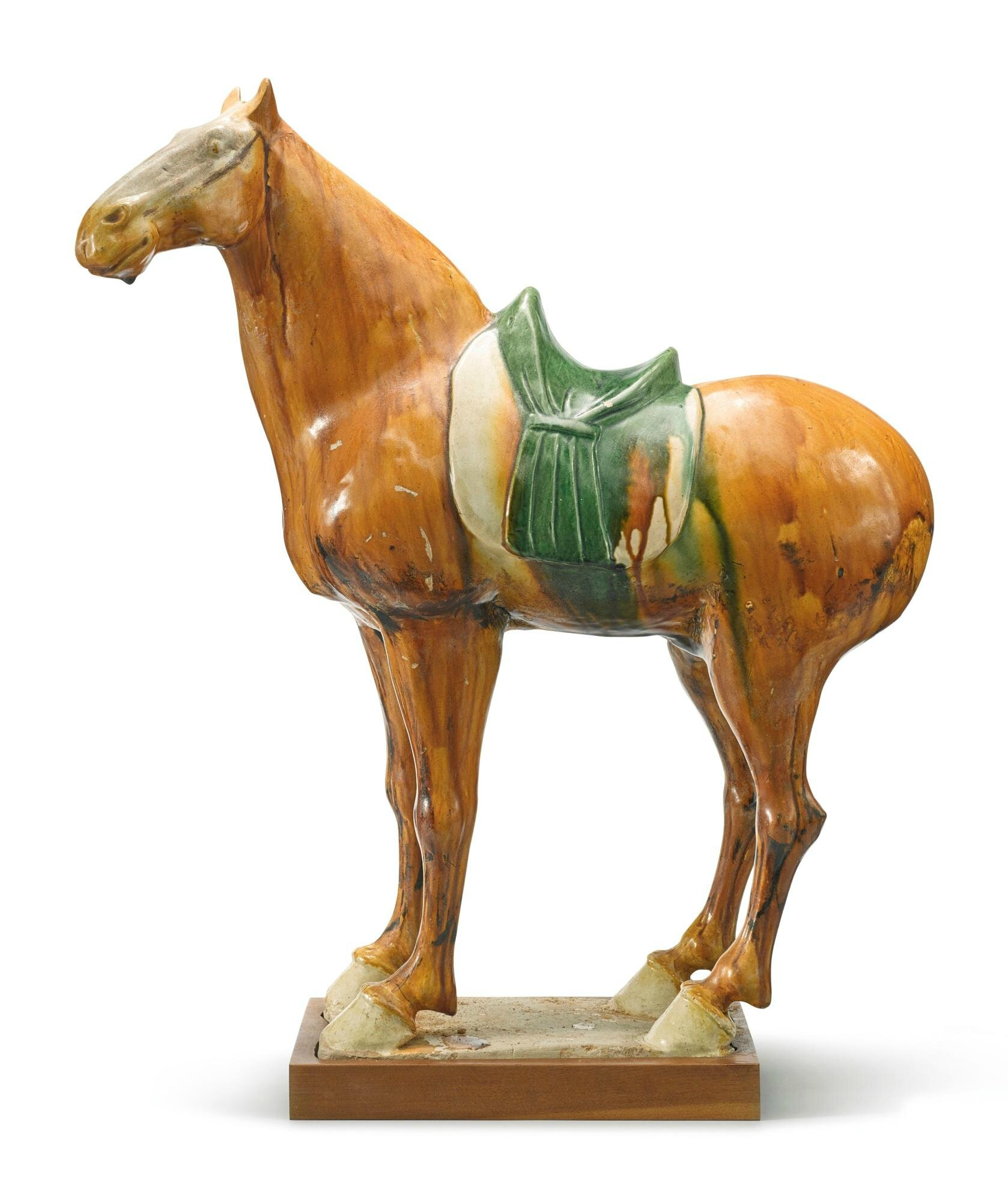 A sancai-glazed pottery figure of a horse, Tang dynasty