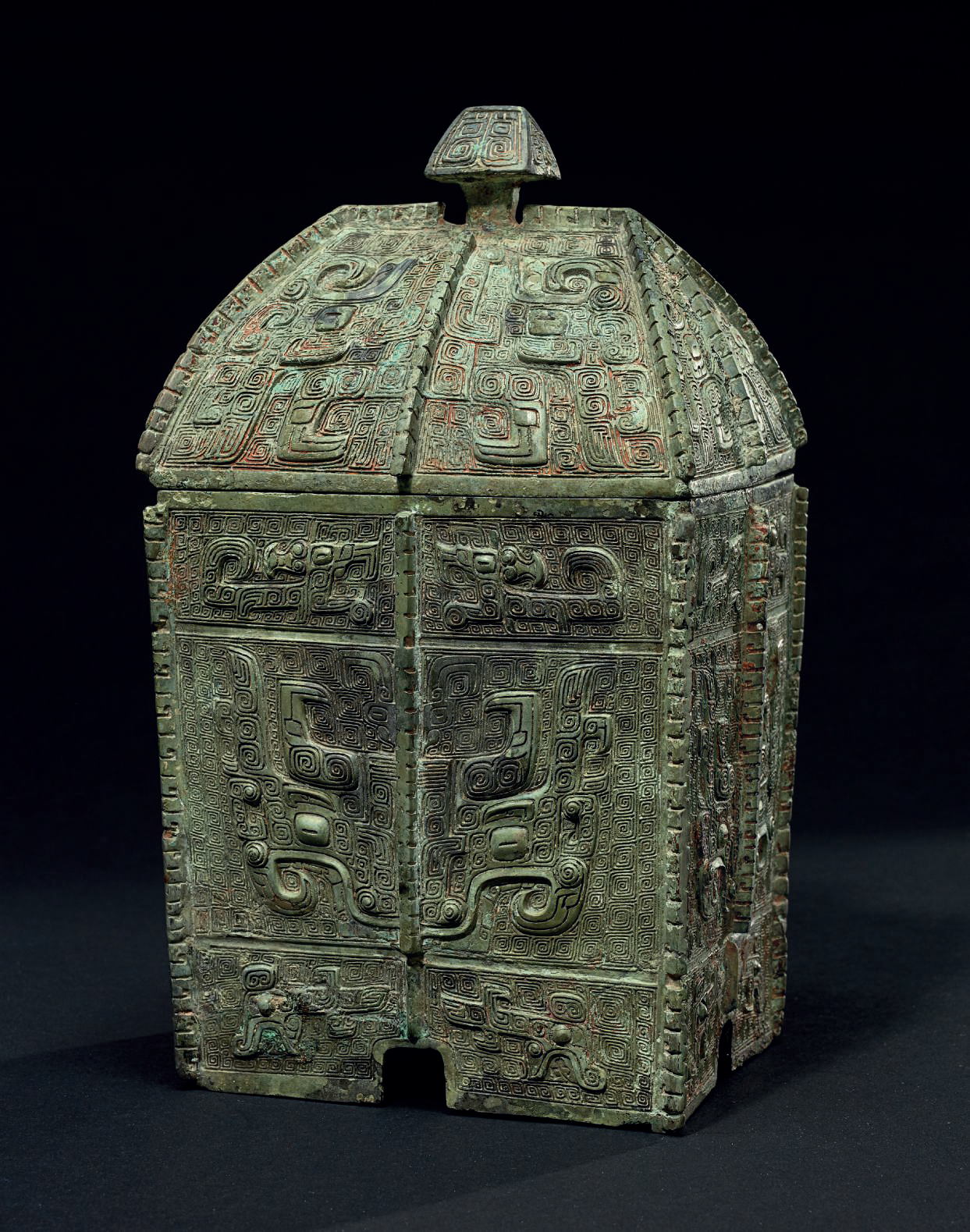 A rare and finely cast bronze ritual wine vessel and cover,fangyi, Late Shang dynasty, 13th-11th century BC