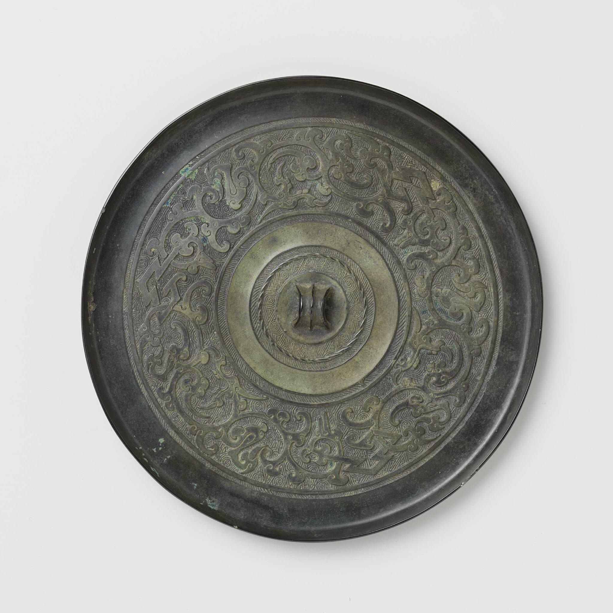Bronze mirror with stylized bird-dragon motifs, Han dynasty, 200-100 BCE