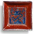 A rare iron-red ground underglaze-blue square dish, mark and period of Jiajing