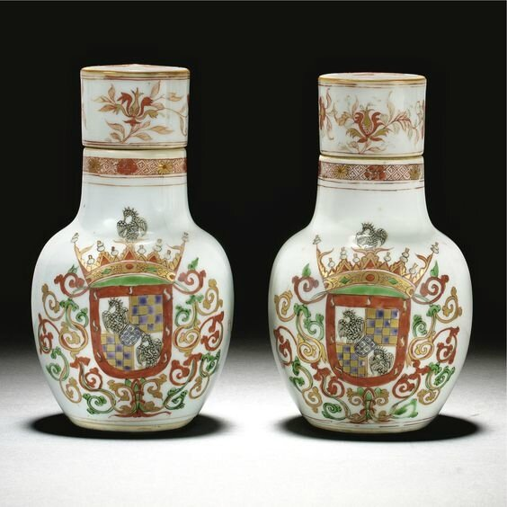 A rare pair of Imari armorial bottles and covers for the Portuguese market, Qing dynasty, Kangxi, circa 1720