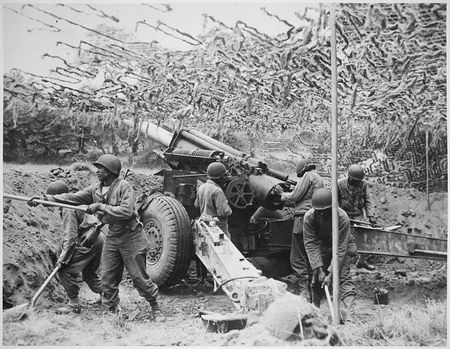773px-Troops_of_a_field_artillery_battery_emplace_a_155mm_howitzer_in_France__They_have_been_following_the_advance_of_the_____-_NARA_-_531198