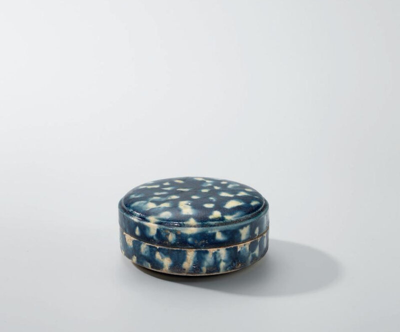 A small blue-glazed reserve-decorated circular box and cover, Tang dynasty (618-907)