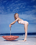 1949_tobey_beach_by_dedienes_umbrella_red_060_1