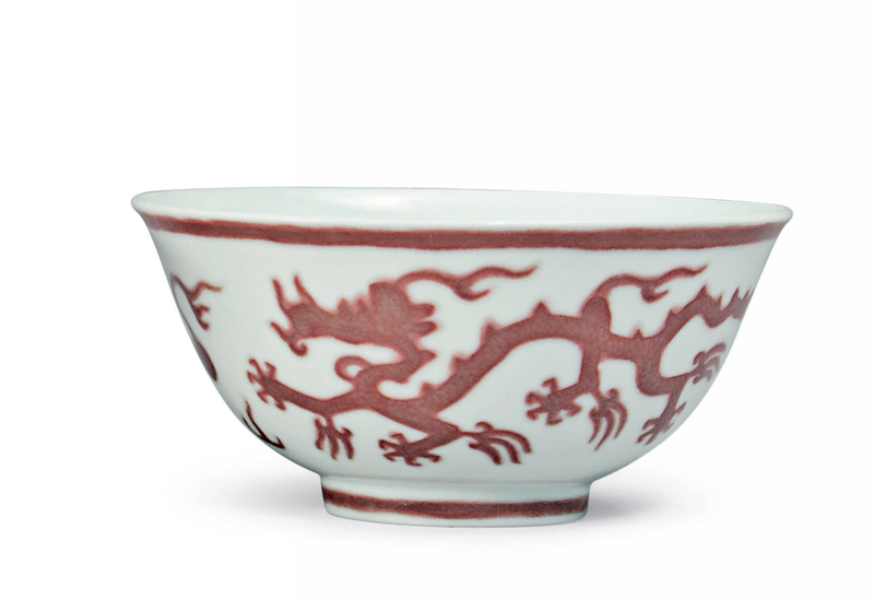 A pair of copper red-decorated 'dragon' bowls, Kangxi six-character marks in underglaze blue within a double circle and of the period (1662-1722) 2