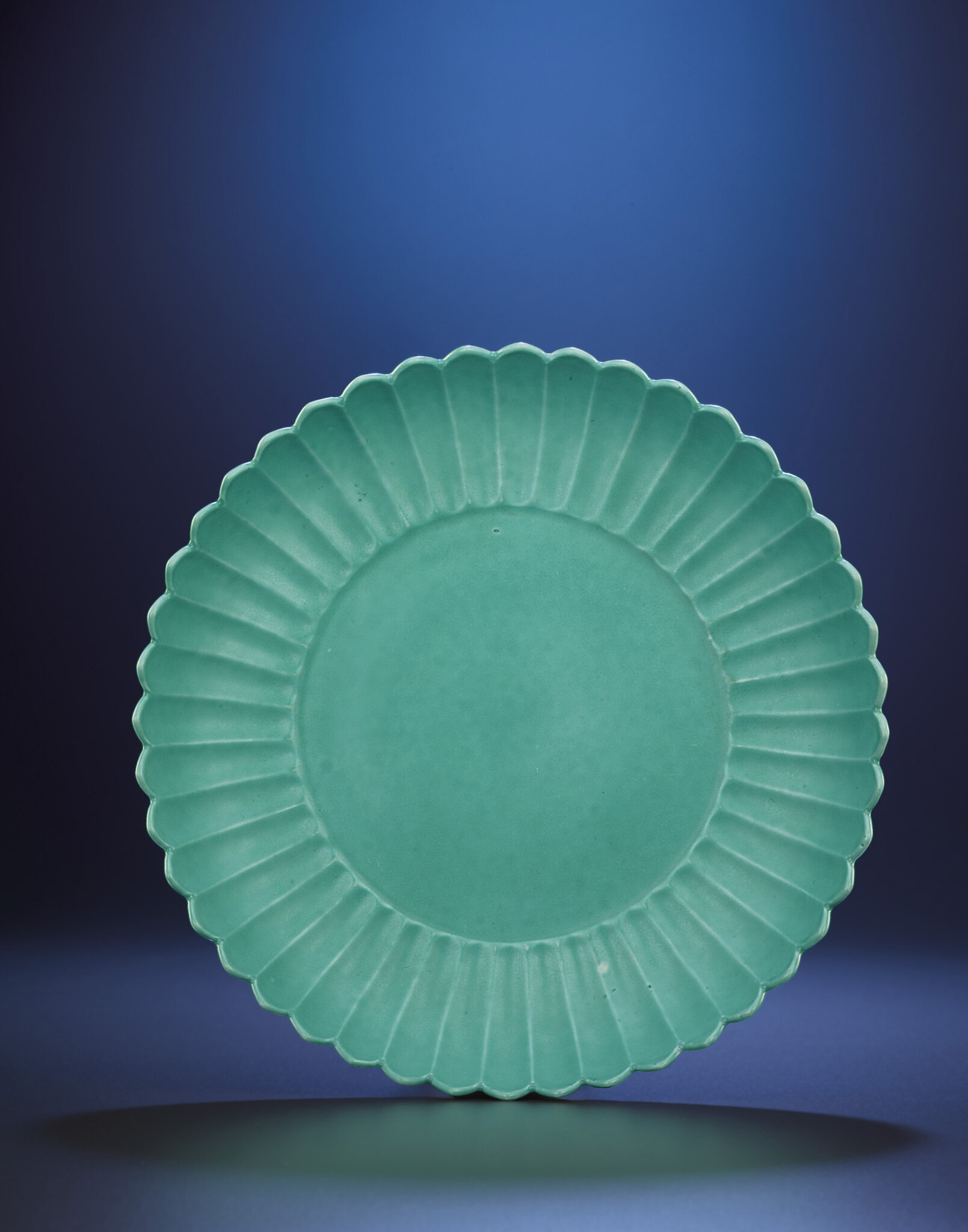 A fine and very rare turquoise enamelled chrysanthemum dish, Yongzheng six-character mark within double-circles and of the period (1723-1735)