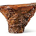 A finely carved rhinoceros horn 'Landscape' libation cup, 17th century