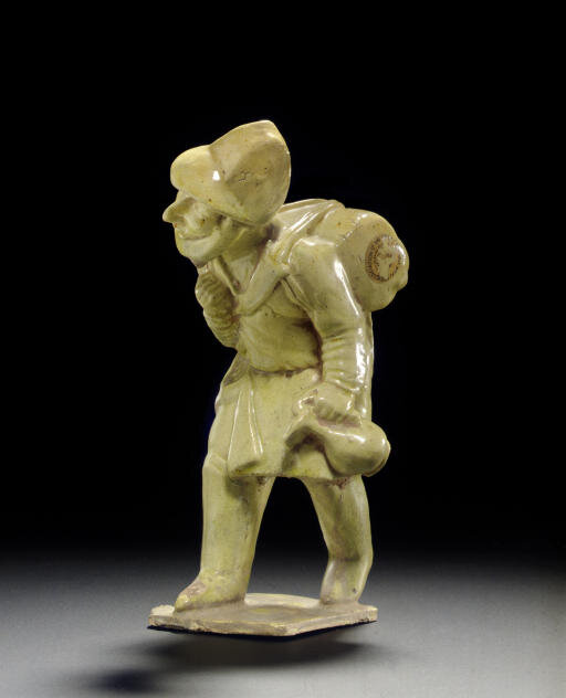 A straw-glazed pottery figure of a foreign merchant, Tang dynasty (618-907)