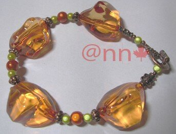 Bracelet acrylique orange, miracle anis (N)