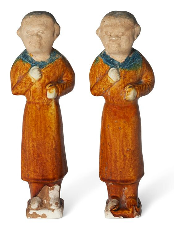A pair of blue and amber-glazed pottery figures of foreigners, Tang dynasty (AD 618-907)