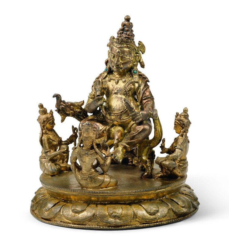 A small gilt-bronze figure of Jambhala, Tibet, 15th century