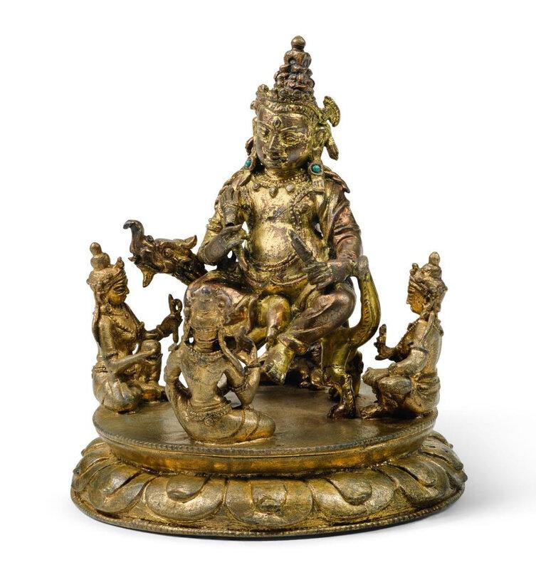 A small gilt-bronze figure of Jambhala, Tibet, 15th century