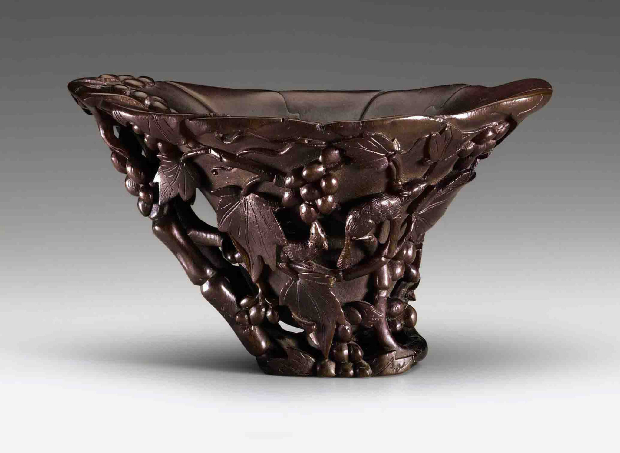 A large 'Squirrels and Grapes' rhinoceros horn cup, 17th-18th century