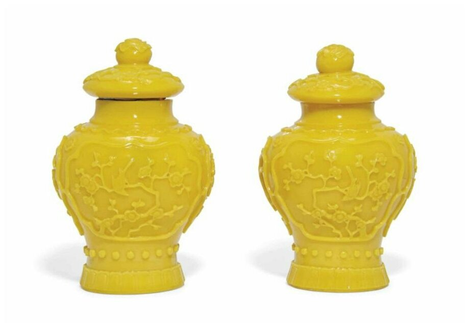 A pair of Chinese yellow glass vases and covers, 20th century