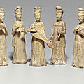 A group of nine straw-glazed female musicians and attendants, Sui dynasty (581-618)