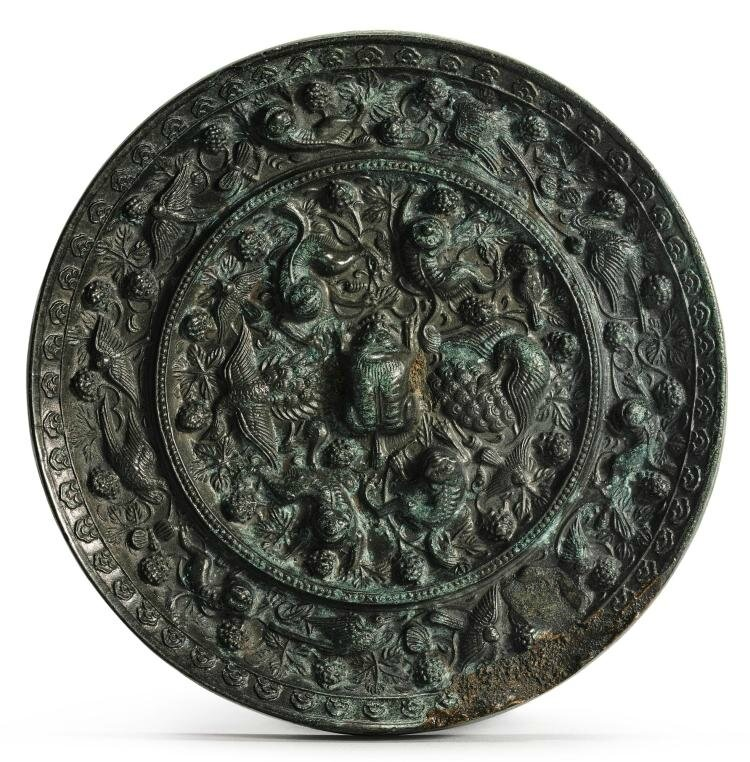 A bronze 'Mythical Beasts and Grapevine' mirror, Tang dynasty