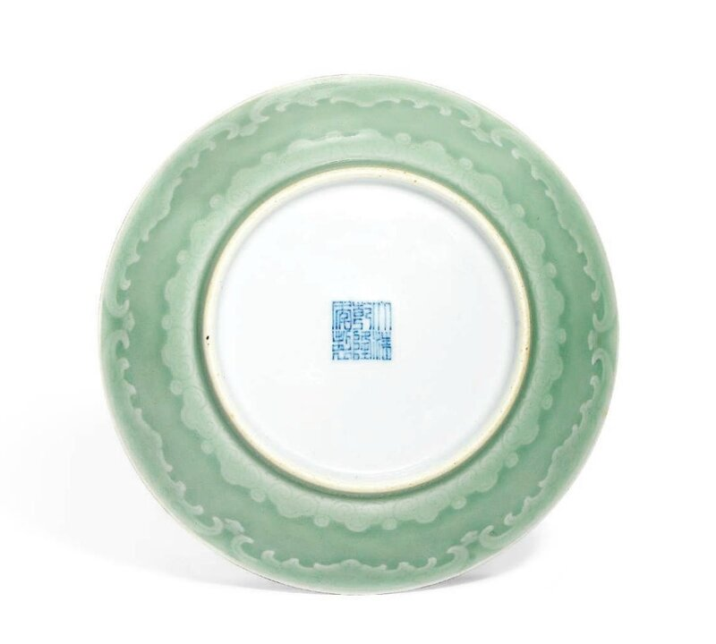 A rare celadon-glazed saucer dish, Qianlong six-character seal mark in underglaze blue and of the period (1736-1795)