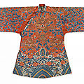 A coral-ground embroidered 'dragon' robe (jifu), qing dynasty, 19th century