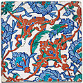 An iznik polychrome pottery tile with interlacing split-palmettes and lotus blossoms, turkey, circa 1570