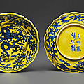 A rare pair of small yellow-ground blue and white lobed dishes, jiajing six-character marks in underglaze blue and of the period
