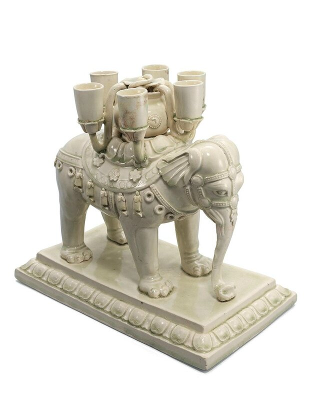 An important and very rare white-glazed 'elephant' candle stand, Sui-early Tang dynasty, 6th-7th century