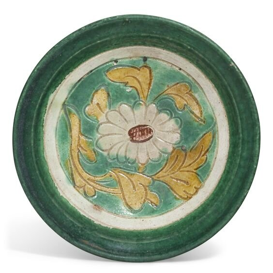 A small green, yellow and cream-glazed pottery dish, Jin dynasty (1115-1234)