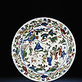 A rare large late Ming wucai dish, Wanli six-character mark within double-circles and of the period (1573-1619)