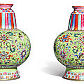 A pair of famille-rose green-ground tibetan-style vases, bumpa, jiaqing seal marks and period (1796-1820)