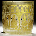 A blue enamelled gold-decorated sandwich glass beaker, probably iran, 9th century