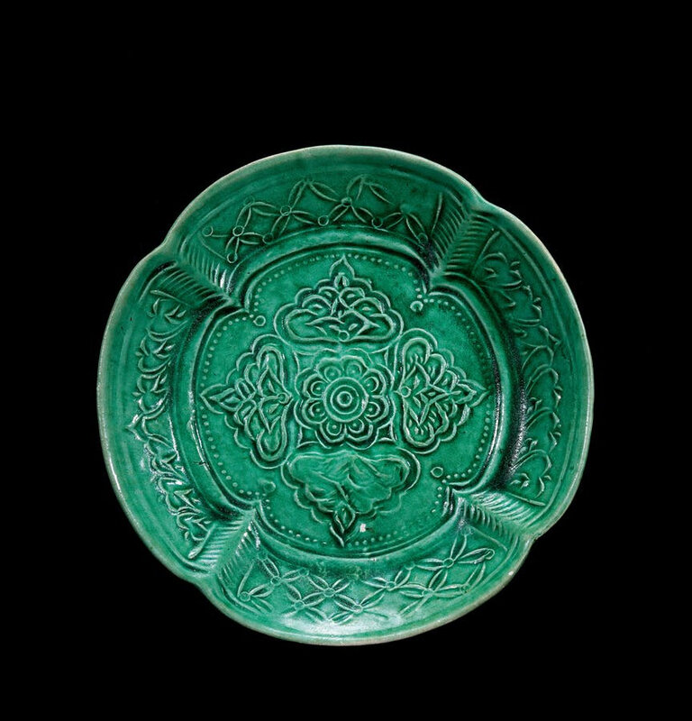 A Molded Green-Glazed Pottery Dish, Liao Dynasty, 10th-12th Century