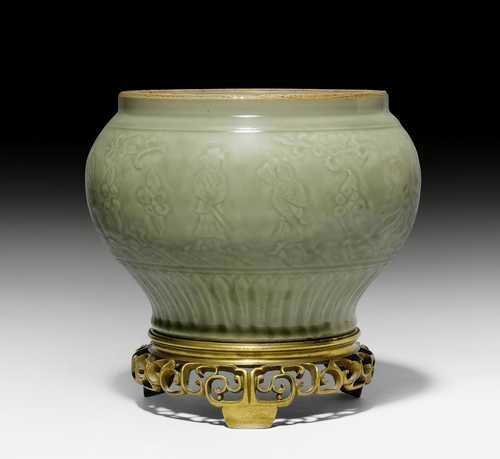A Longquan celadon baluster jar carved with the Eight Immortals, China, Yuan-early Ming dynasty