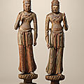 A highly important majestic pair of wood figures of standing bodhisattvas, five dynasties-northern song dynasty (10th-11th centu