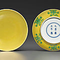 A fine pair of small green-decorated yellow-ground dishes, yongzheng six-character marks and of the period (1723-1735)