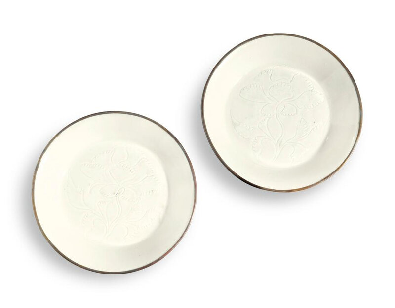 Two small carved Ding dishes, Northern Song dynasty (960-1127)