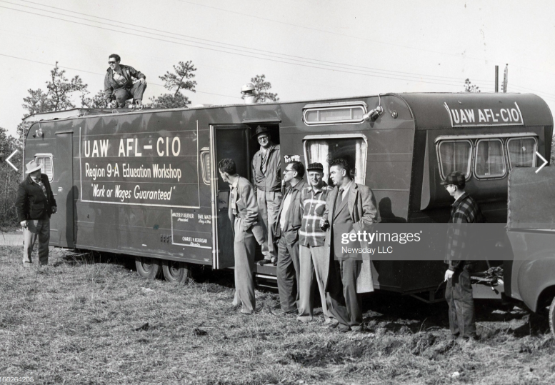 2019-11-11 23_49_08-Members of UAW-CIO union stand near the union's trailer for strikers