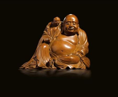 A_carved_boxwood_seated_buddha