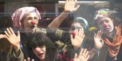 1-members-of-clowns-army-look-out-of-a-bus-window-after-their-bus-was-stopped-from-going-to-downtown-strasbourg_399