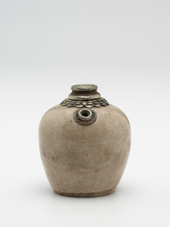 Lidded water dropper, Vietnam, 11th century-13th century, earthenware, glaze, metal; (a-b) 9