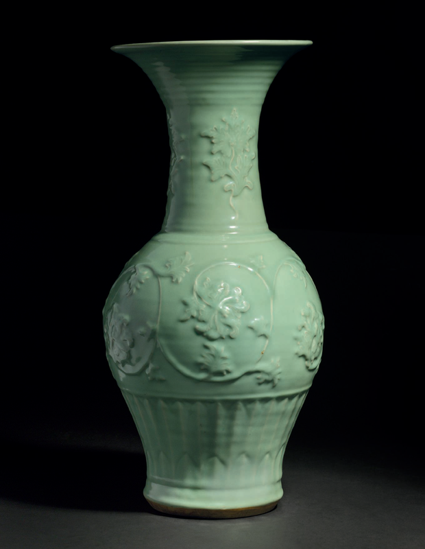 A superb large carved and molded Longquan celadon 'phoenix-tail' vase, Yuan dynasty, 14th century