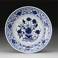 A small ming-style blue and white dish. qianlong seal mark and period