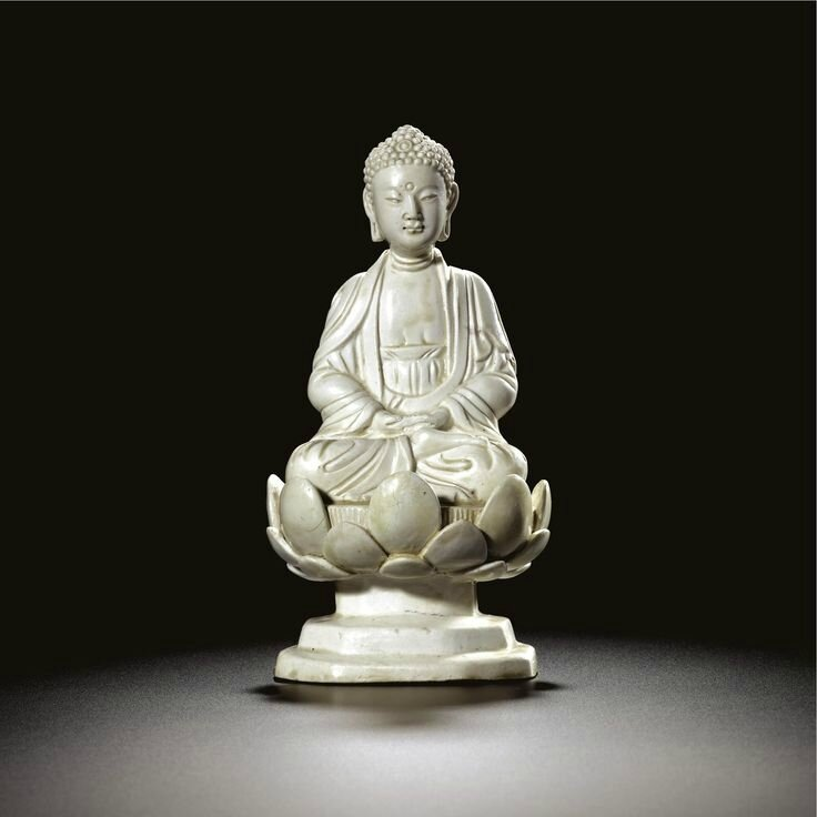 A rare white stoneware figure of a seated Buddha, Northern Song-Jin dynasty (960-1234)
