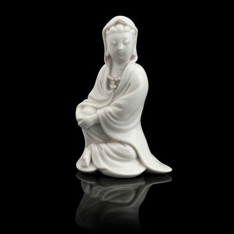 A small blanc-de-chine figure of a seated Guanyin, 18th century. Photo Bonhams.