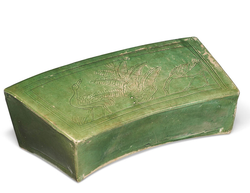 A green and amber-glazed pillow, Liao dynasty (907-1125)